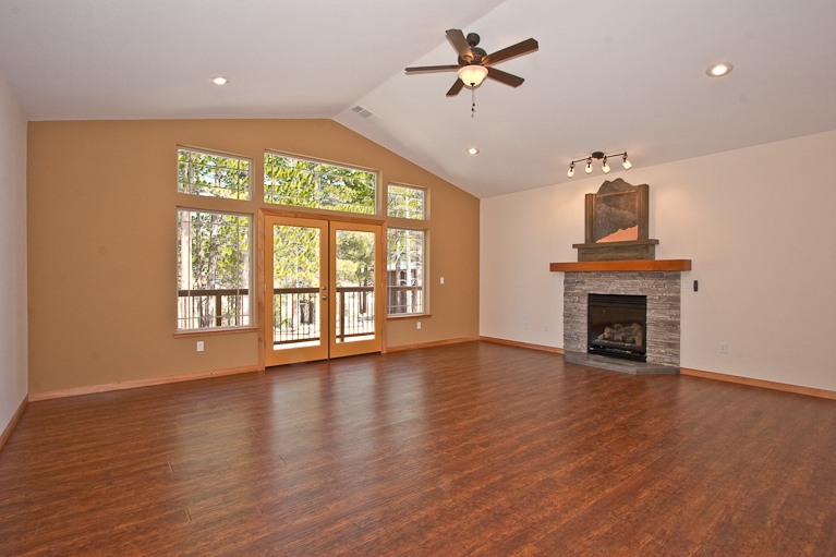 living area, views, gas fireplace, stone surrond, windows, french doorswater fountain