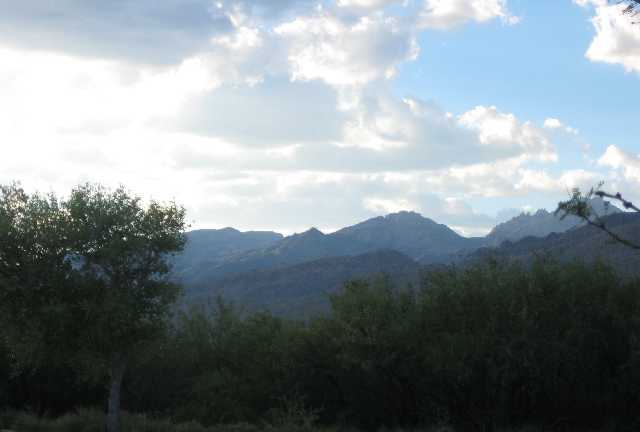 Santa Catalina Mountains Backdrop with cloudy blue skies