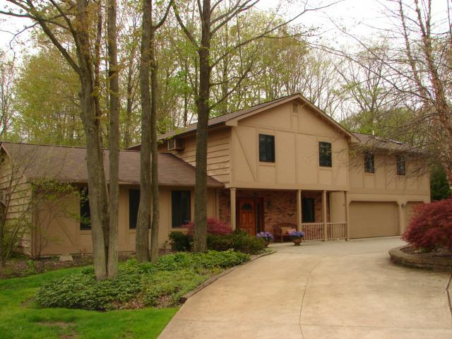 Stucco Home, Turn Around Drive.  Wooded Lot