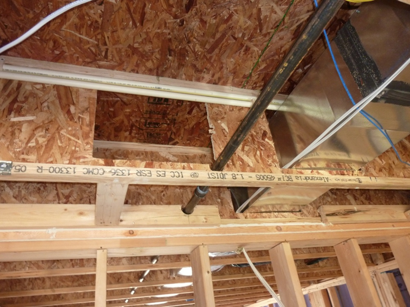 Wood Truss Repair : Notching or cutting holes in engineered floor joists