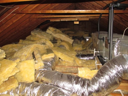 Insulation piled high in an attic