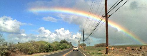 bright rainbow while driving on Maui