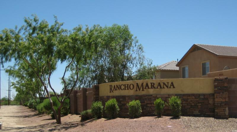 Rancho Marana wall with green trees and blue sky