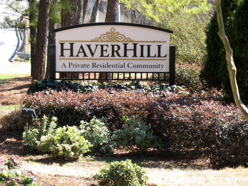 Entrance sign nestled in trees at N. Druid Hills Road