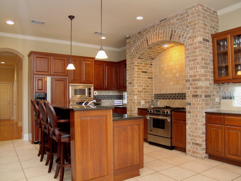 The Gourmet style kitchen features custom built cabinets, high-end granite countertops