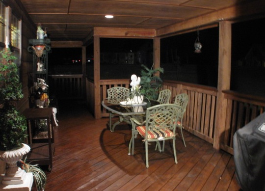Lake Livingston Real Estate :Outdoor Eating and grilling area with 2 natural gas hubs for grill and even an outdoor fireplace!