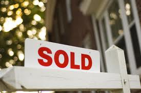 SOLD SIGNS ON HOUSES
