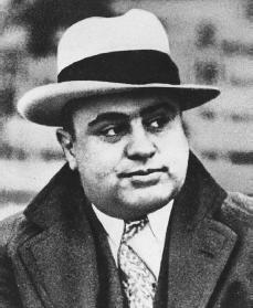 a biography and life work of alphonse al capone an american gangster Considered the most notorious gangster in history, alphonse capone, otherwise known as scarface al, was born in new york, 1899, in a small apartment in the williamsburg section of brooklyn having many run-ins with the police growing up, he was always around the local street gang led my johnny.