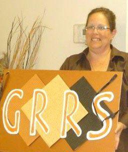 Kim Jones with GRRS Sign HomeRome Realty