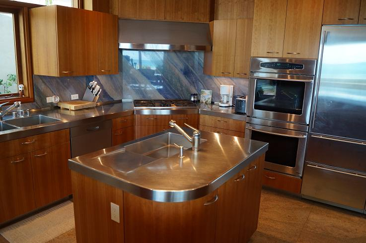 Stainless steel kitchen area that has a private drop down panel.