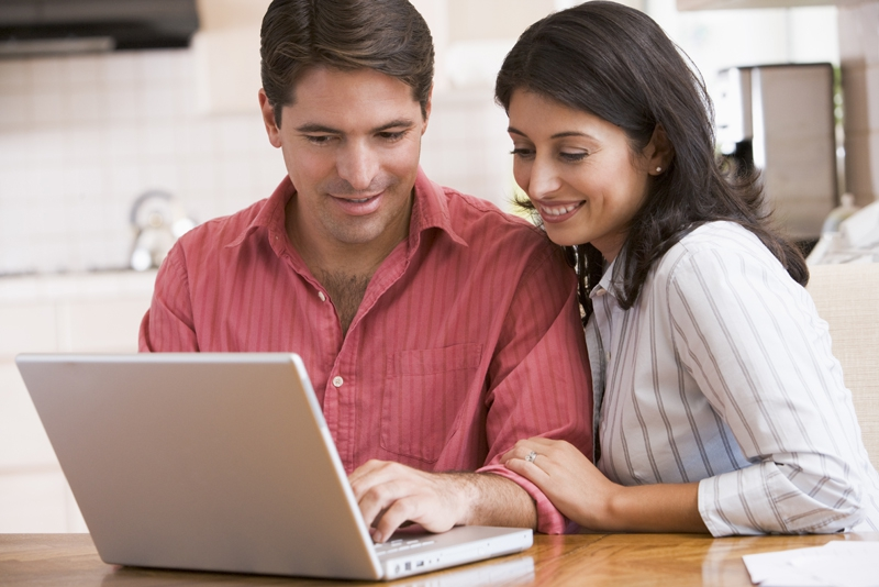 Older couple looking at a real estate site on their laptop