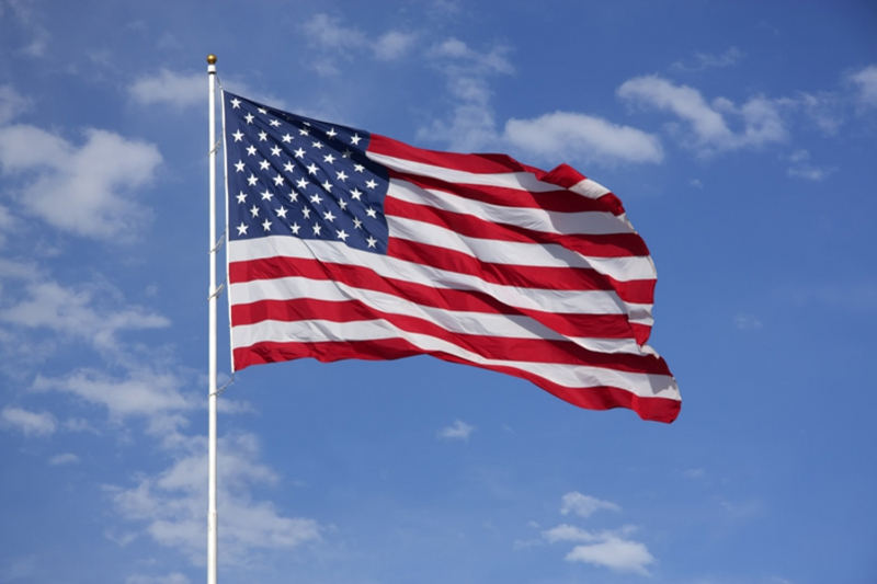 U.S.Flag flying in air