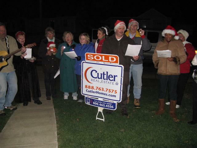 Staff and agents Christmas caroling 2008