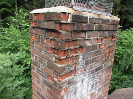 Spalling bricks on a chimney in Connecticut