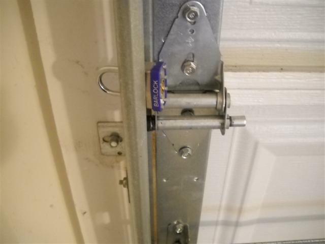 Padlock on garage door track & Unseen Locks on Garage Door Tracks - Trouble Waiting to Happen!