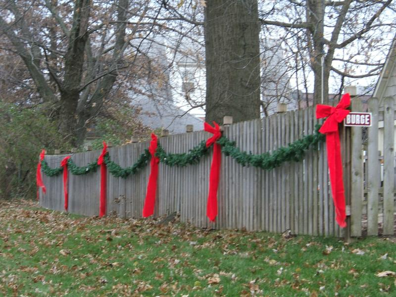 Christmas bows on wooden fence