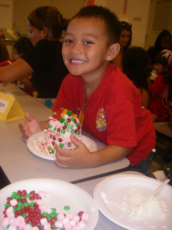 Grandson Landon with Gingerbread House