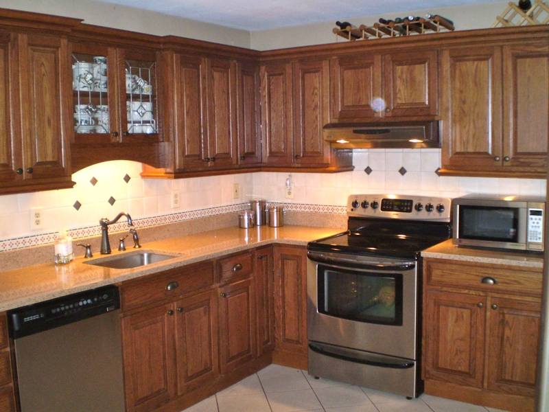 Beautiful oak cabinets - love the trim along the bottom. The ...