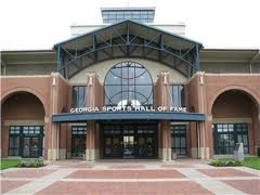 Georgia Sports Hall of Fame - Courtesy of Warner Robi</a></noscript> is located at 301 Cherry Street in Macon Georgia and is both the official sports muesum and the largest state sports museum for the state of Georgia.</p> <p>The museum stretches over 43,000 square feet and displays over 3,000 sports related memorabilia from Georgia and around the world.</p> <p>Sports history, interesting displays, pristine artifacts, inductee tidbits, and a host of other interesting sports items await.</p> <p> </p> <p>The museum currently showcases two temporary exhibits, the Art of Jack Davis (co-creator of <em>Mad</em> magazine) and Super Men: Georgia Football Greats in the NFL's Biggest Game.</p> <p><a title=