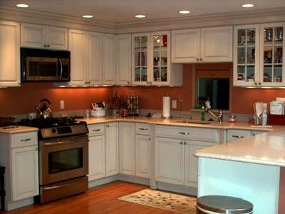 in a functional but dated kitchen with 30 linear feet of cabinetry and countertops leave cabinet boxes in place but replace fronts with new