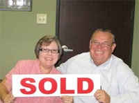 Huntsville ISD New Interim Superintendent at closing with wife Mary Ellen, home purchase with Their Singing Realtor, Mari Montgomery
