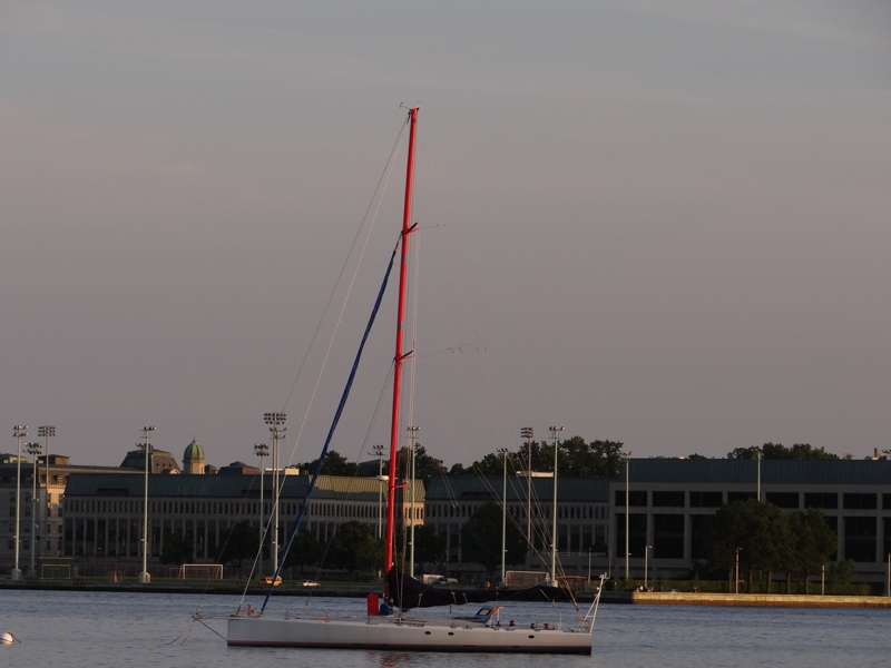 Sail boat on Severn River in Annapolis with the NAval Academy in the background