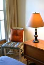 Lamp and Side Chair with pillows