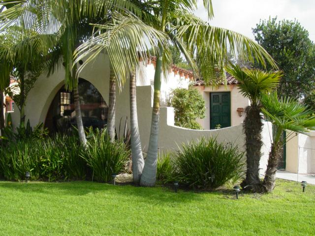 Gorgeous Spanish Style Bungalow Home With Tropical Plant Landscaping And Terracotta Tiled Roof