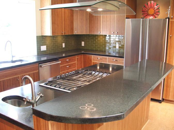 with the bamboo cabinets and the glass subway tile backsplash