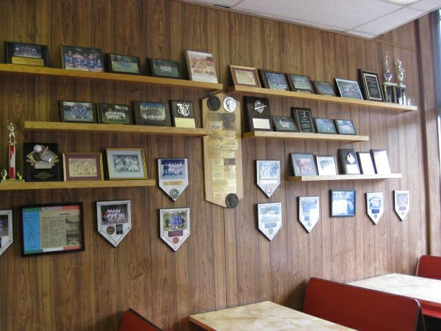 Wall covered with Little League team photos