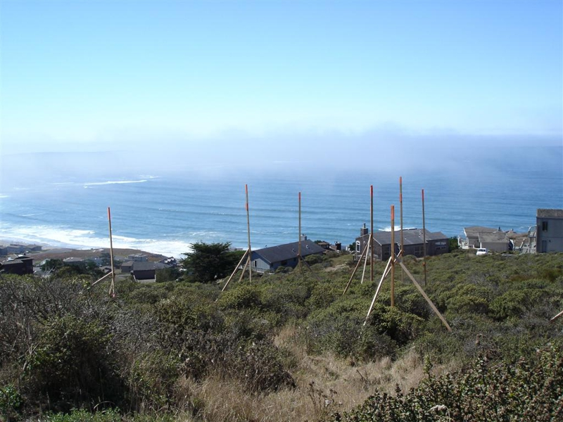 story poles erected on an ocean view lot