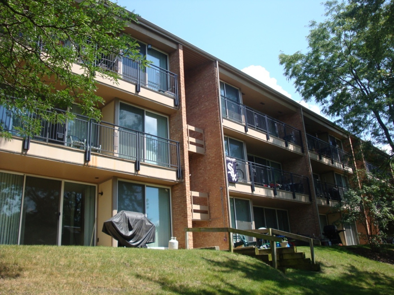 The back decks of the Four Lakes Condos
