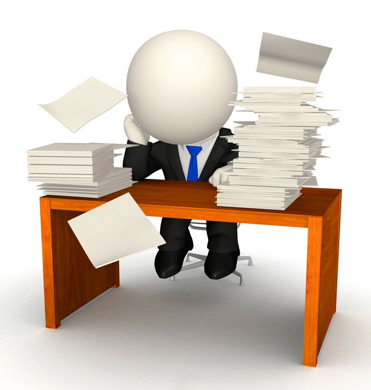 man at desk with paperwork