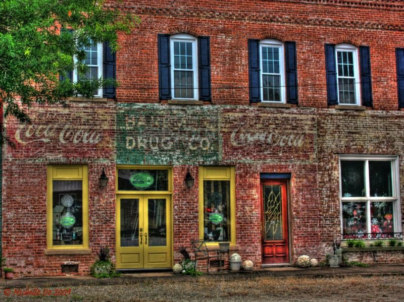 Vintage Coca-Cola sign on a Colbert, GA storefront by Michelle De 2009