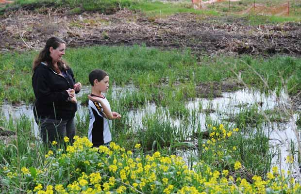 Michelle Ruediger and her son Tyler, 8, enjoy the surroundings near 119 Street and 169 Avenue in the unfinished neighbourhood of Castlewood.