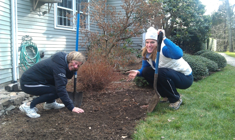Justine and Dagny planting bulbs in Wilton CT