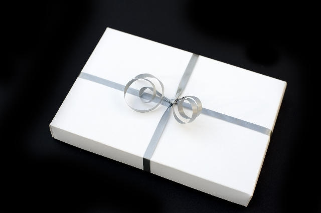 white boxed gift with silver ribbon bow