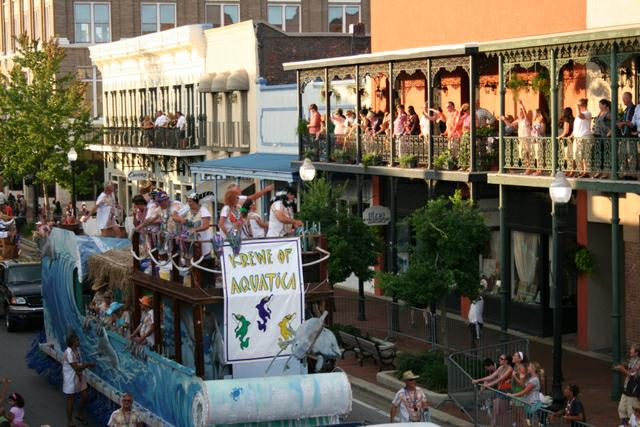 Floats Glide Past Historic Storefronts and Homes in Downtown Pensacola
