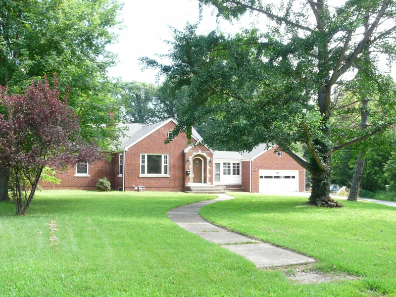 full brick ranch on almost one acre in the heart of