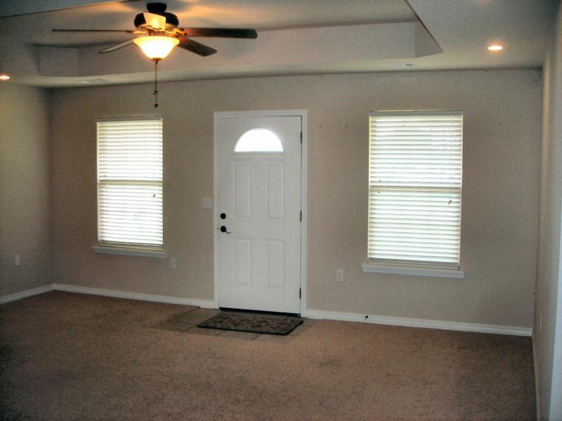 Living room view, step ceiling ceiling fan, blinds