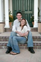 Couple sitting on steps of new home