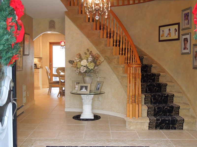 Another Feature Of This Staten Island NY Home Is The Magnificent 2 Story  Entry Foyer With Circular Staircase   Adding A Touch Of Class To This Home.