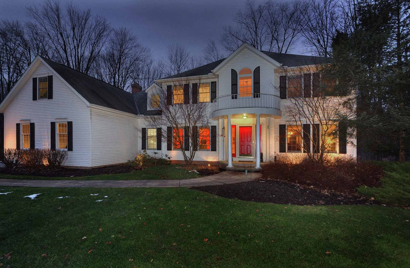 Solon luxury home Chagrin Highlands at night