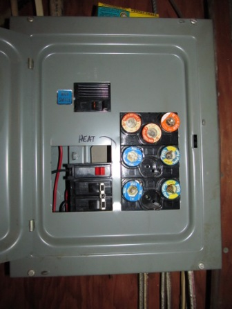 A combination fuse and breaker electric panel