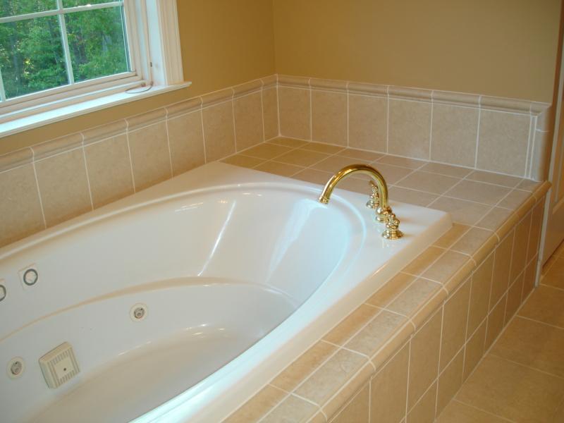 Master bath redone charlottesville blog for Tiling around a bath