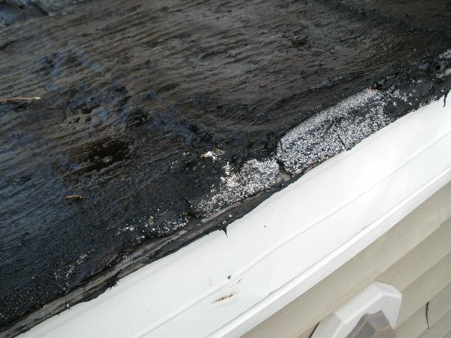 Tar over Roll Roofing