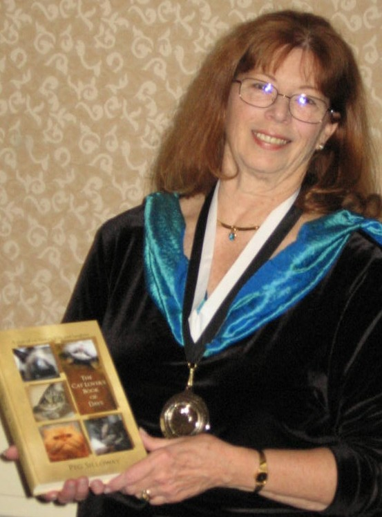 Peg Silloway with her Muse  Medallion and  book