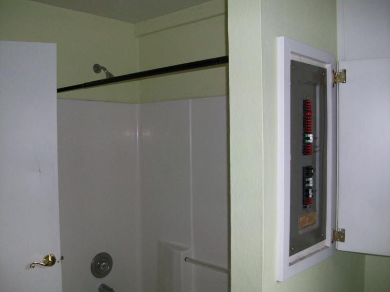 in the field electrical panel in bathroom by shower