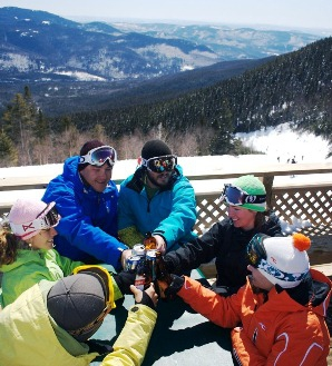Skiers & riders enjoy a break on the Schwendi Hutte deck at Waterville Valley Resort, NH