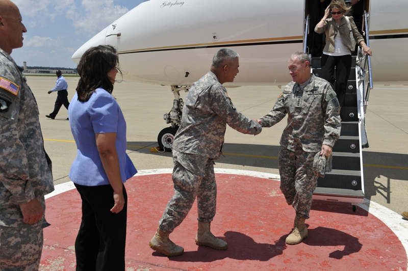 "The Chief of Staff of the Army (CSA) General Martin E. Dempsey is greeted by Maj. Gen. John F. Campbell during a visit to Fort Campbell where he and his wife Deanie met with Soldiers and their spouses Thursday, 23 June, 2011. ""They have really written another page in their extensive history and I think it's one of those places you come to remember, why we do what we do,"" he said. (Official Army photo by: Jerry Woller)"